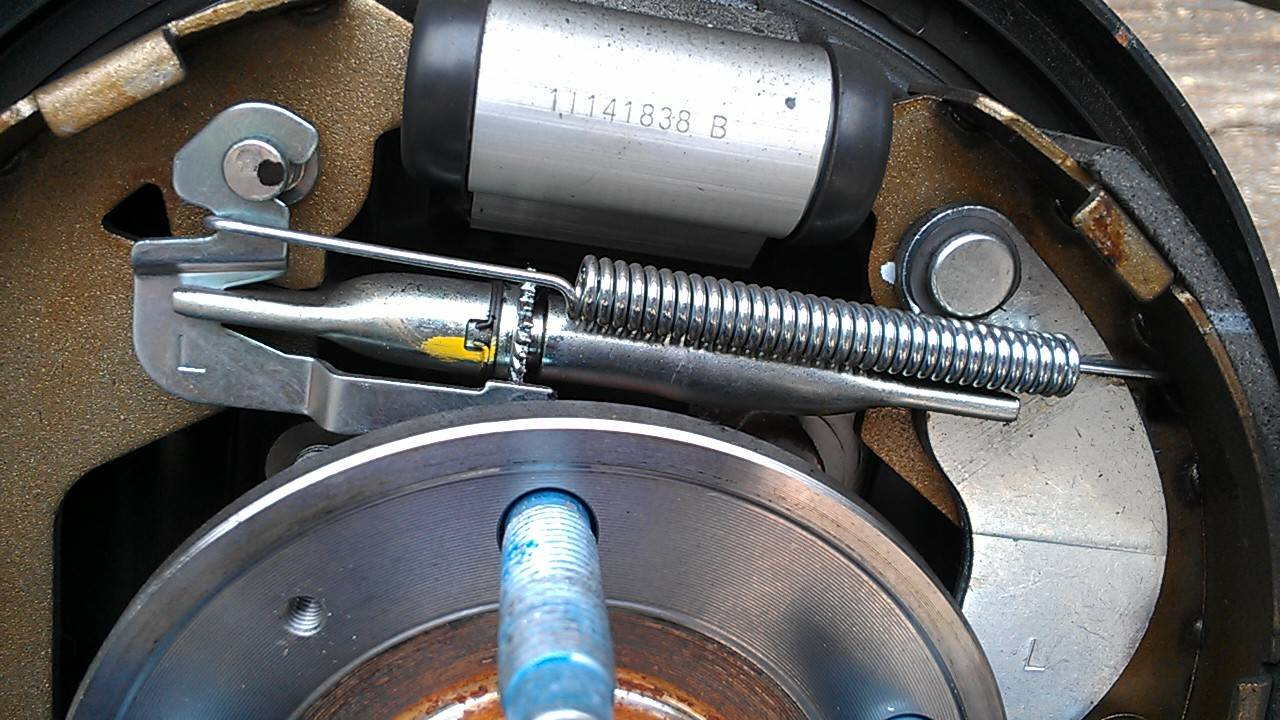 how to adjust rear drum brakes